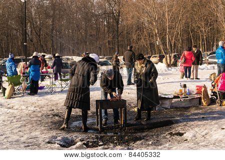 A Russian Family Having A Shashlik