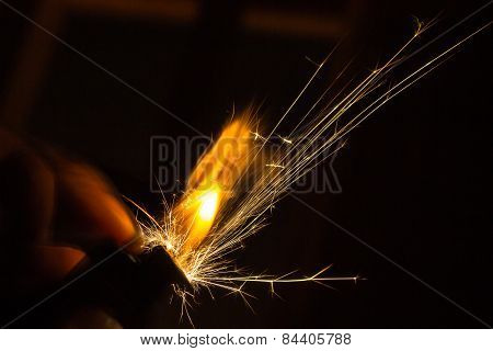 Sparks And Flames From A Lighter
