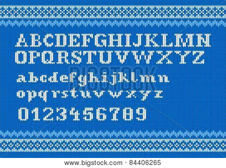 White Knitting Alphabet On Blue Background