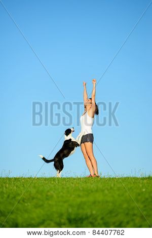 Sporty Woman And Dog Celebrating Workout Success