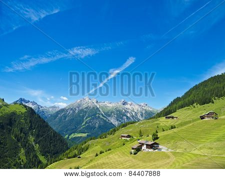 farmhouses and alpine Landscape