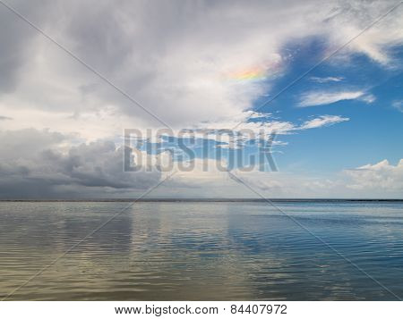 Reflection And Unusual Rainbow