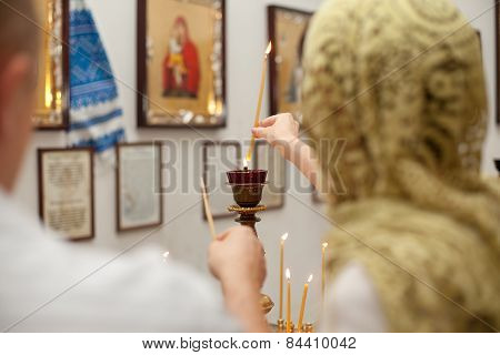 Female And Candle In Church