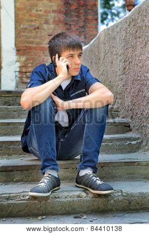 Sad Teenager With Cellphone