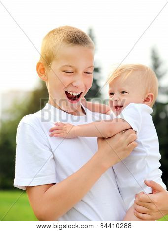Happy Kid And Baby Outdoor