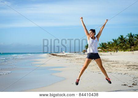 Female Athlete Jumping At Beach
