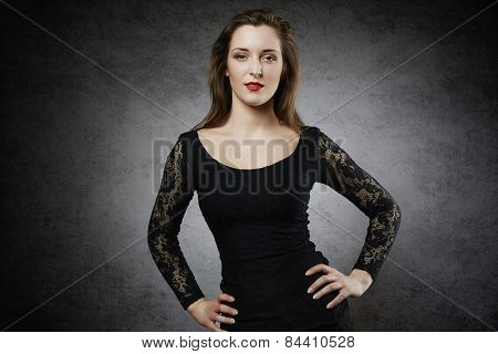 Attractive young woman with hands on her hips