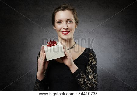 Beautiful smiling woman with gift box