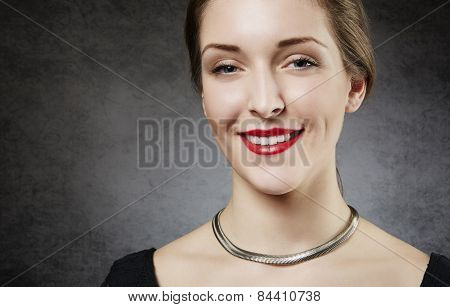Beautiful smiling woman with red lips