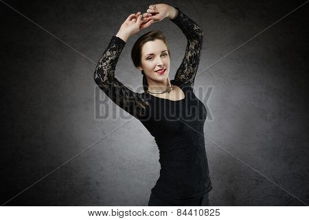 Joyful attractive woman with raised hands