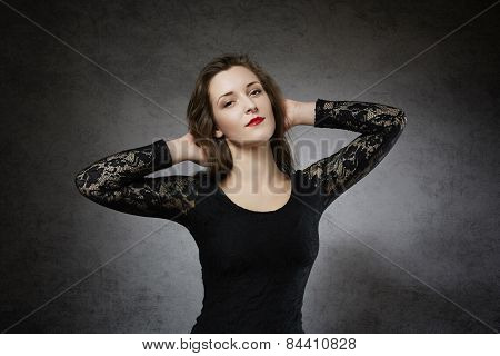 Flirting young woman in lace dress