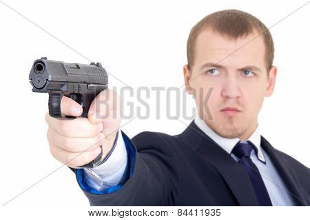 Serious Man In Business Suit Shooting With Handgun Isolated On White