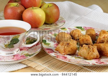 Bakhlava And Tea In A Flowered Antique Teacup