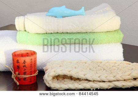 Towel Stack And Bast In Shower.