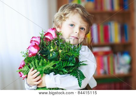 Happy Smiling Little Boy With Blooming Pink Roses In Bunch