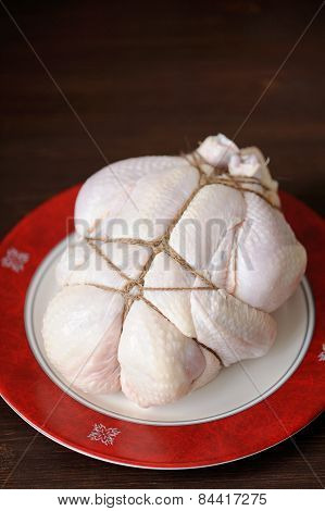 Bondage Shibari Raw Chicken On Red Boarder Plate On Dark Wood Background