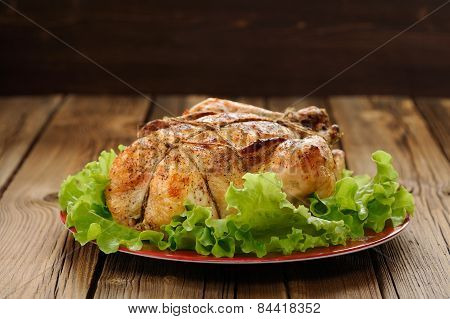 Bondage Shibari Roasted Chicken With Salad Leaves On Red Plate On Wooden Background With Dark Space