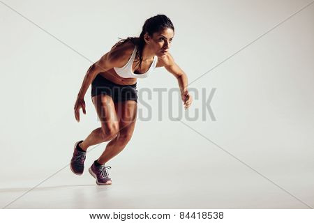 Young Woman Starting To Run And Accelerating