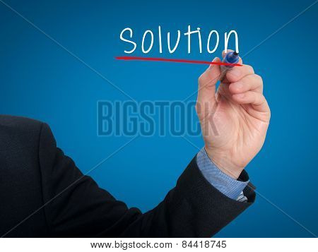 Businessman hand writing solution. Stock photo