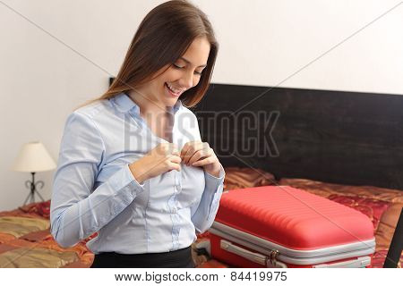 Business Woman Traveler Undressing In A Hotel Room