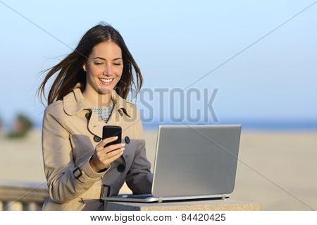 Self Employed Woman Working Outdoors On The Phone