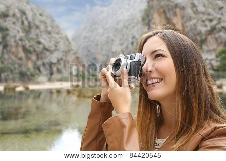 Tourist Traveler Woman Photographing A Landscape In The Mountain