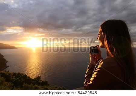 Traveler Tourist Girl Taking Photo In A Sunset On The Vacations