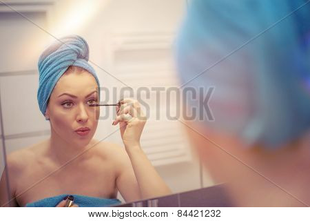 Young Woman Looking In The Mirror And Putting Make-up On. Instagram Filter