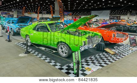 Three AMC Javelin AMX Cars