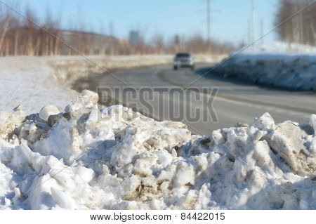 Old snow beside the road