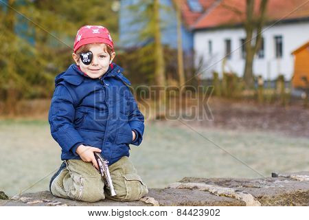 Little Preschool Boy Of 4 Years In Pirate Costume, Outdoors.