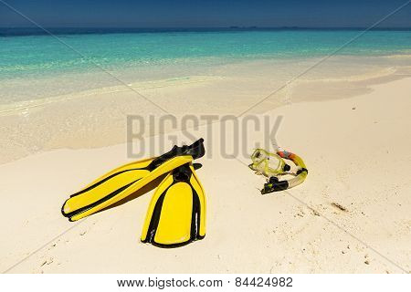 Snorkeling Equipment Mask, Snorkel And Fins On Sand At Beach