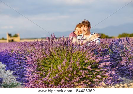 Romantic Couple In Love In Lavender Fields In Provence, France