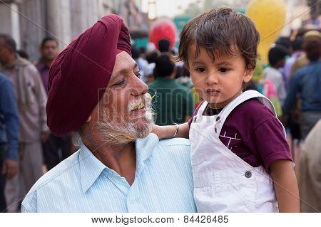 Delhi, India - November 5: Unidentified Man With Unidentified Child Walks At Chandni Chowk On Novemb
