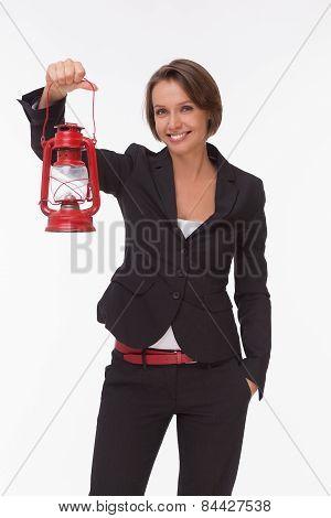 Businesswoman  with red kerosene lamp