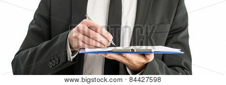 Writing Notes On Paper In Clipboard Folder