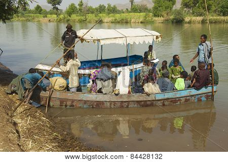 Passengers cross the Blue Nile river by local ferry boat in Bahir Dar, Ethiopia.