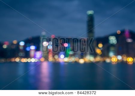 Blured lights of Hong Kong city twilight with water reflexion