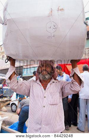 Delhi, India - November 5: Unidentified Man Carries Bundle On His Head At Chandni Chowk On November
