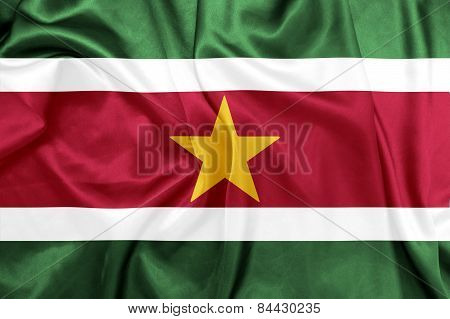 Suriname - Waving national flag on silk texture