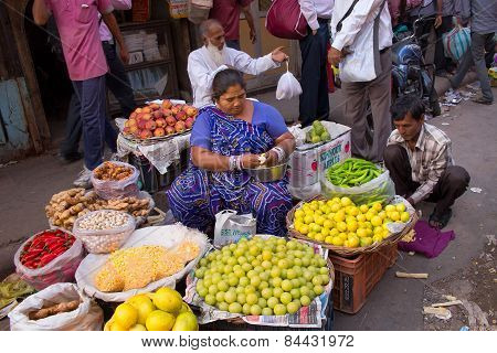 Delhi, India - November 5: Unidentified Woman Sells Fruits On November 5, 2014 In Delhi, India. Stre