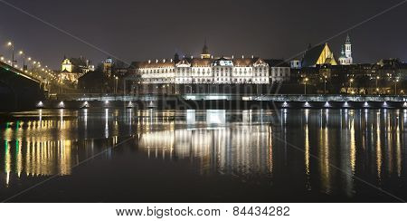 Panoramic View Of Warsaw Waterfront By Night.