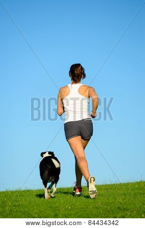 Woman And Dog Running At Park Outdoor