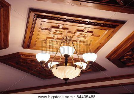 Retro Chandelier On Wooden Ceiling