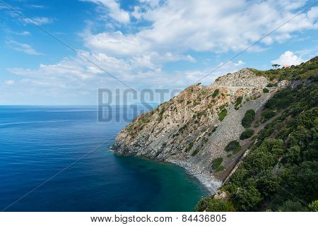 blue sky and clouds over ocean and coastline of elba