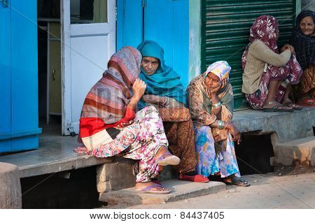 Indian Women Sit And Chat On A House Porch