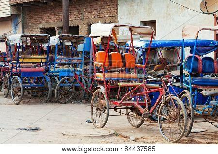 Many Bicycle Rickshaws On Parking