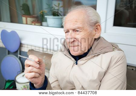 Old Man Holding A Cigarette