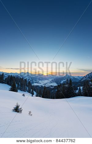 view to sunset in austrian alps at snowy winter