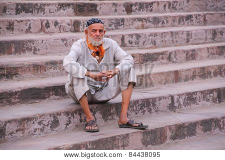 Delhi, India - November 5: Unidentified Man Sits On The Stairs Of Jama Masjid On November 5, 2014 In